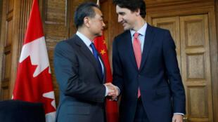 資料圖片:2016年6月1日中國外長王毅在渥太華與加拿大總理杜魯多會談