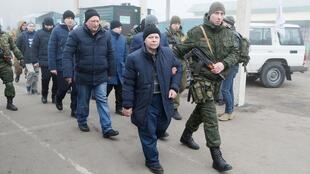 Released detainees are escorted by pro-Russia separatists in an exchange of prisoners near the Mayorsk crossing point in Donetsk region, Ukraine, 29 December 2019.