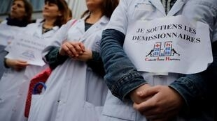 Health workers from the Saint-Louis hospital in Paris demonstrate on February 3, 2020.