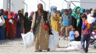 Les civils fuyant Mossoul pris en charge à Daquq en Irak, le 13 octobre 2016