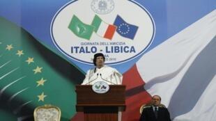 O chefe de estado da Líbia, Muammar Kadafi, durante discurso em Roma, nesta segunda-feira.