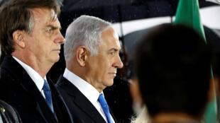 Los presidentes Jair bolsonaro (Brasil) y Benjamin Netanyahu (Israel), durante la ceremonia de acogida en el aeropuerto internacional Ben Gurion. Lod, Israel, 31 de marzo de 2019.