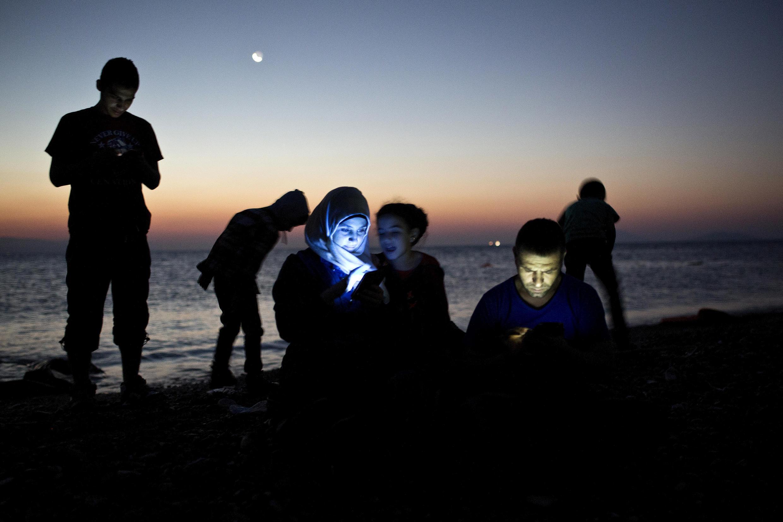 Сирийские мигранты после прибытия на греческий остров Кос. Фото из архива
