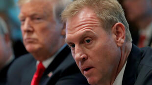 U.S. President Donald Trump (L) listens next to Acting U.S. Defense Secretary Patrick Shanahan during a Cabinet meeting on day 12 of the partial U.S. government shutdown at the White House in Washington, U.S., Jan. 2, 2019.