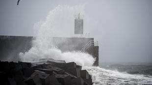 Waves hit the jetty of the port of A Guarda, northwestern Spain, during Storm Fabien, on 21 December, 2019, on its way to southern France