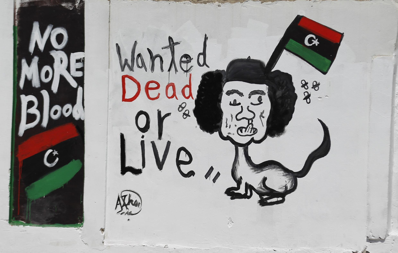 Caricatura de Kadafi. Trípoli, el 30 de agosto de 2011.