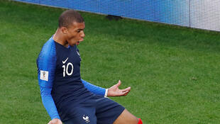 France's Kylian Mbappe celebrates sscoring against Peru on June 21;