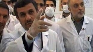 Iran's President Ahmadinejad watches from a control room as nuclear fuel rods are loaded into the Tehran Research Reactor