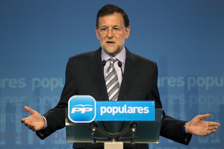 Кандидат от правой оппозиционной Народной партии Мариано Рахой на пресс-конференции в Мадриде 29/07/2011
