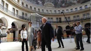French businessman Francois Pinault (C) tours the former stock exchange building within the presentation of the project for the future museum of the Pinault Foundation, on June 26, 2017 in Paris.