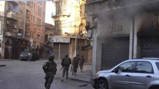 El Ejército libanés en plena acción en el centro de Trípoli, 25 de octubre de 2014.