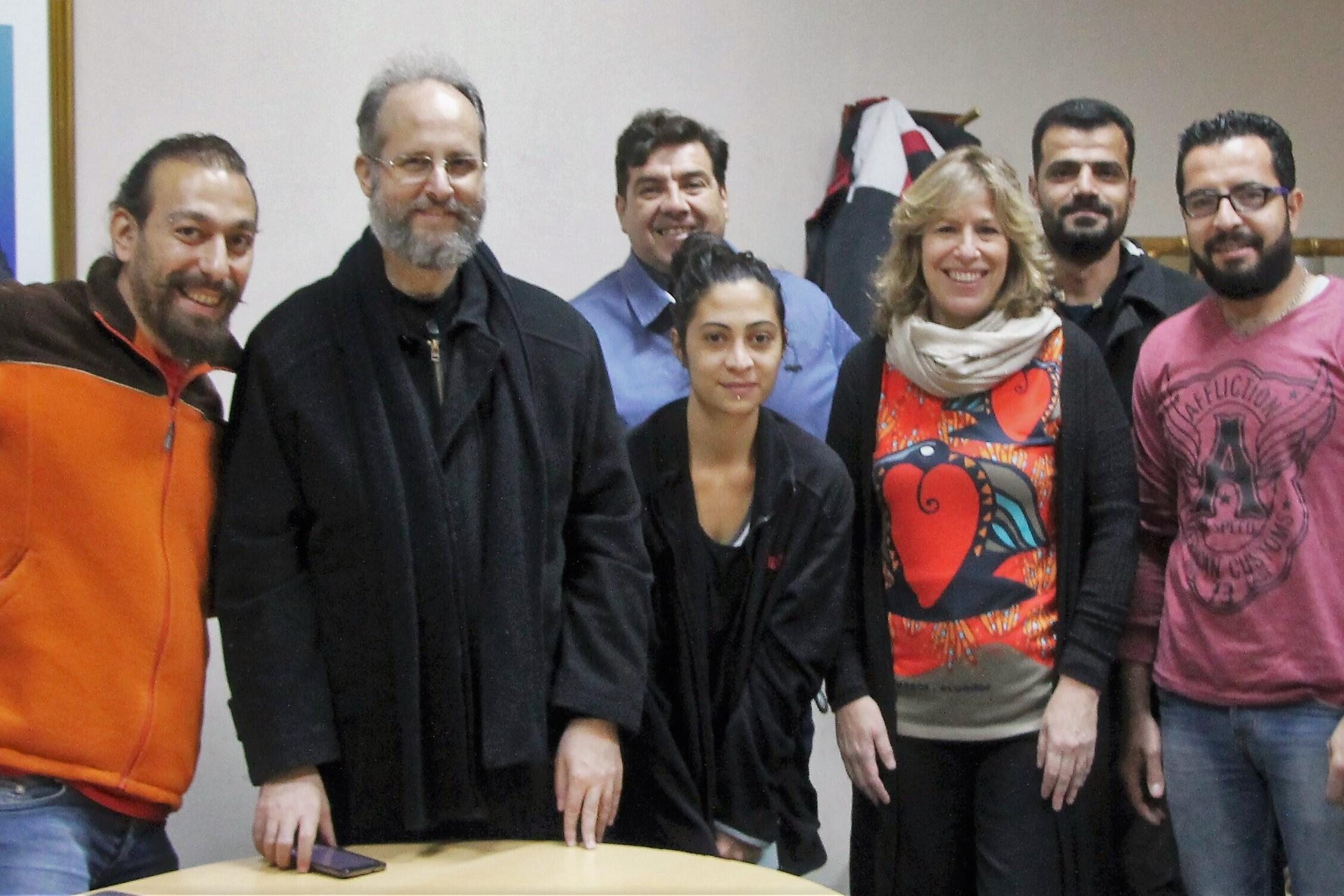 Syrian refugees, the Archbishop of the Orthodox church of Antioch (Monseñor Siluan), and representatives of San Luis' government, Argentina