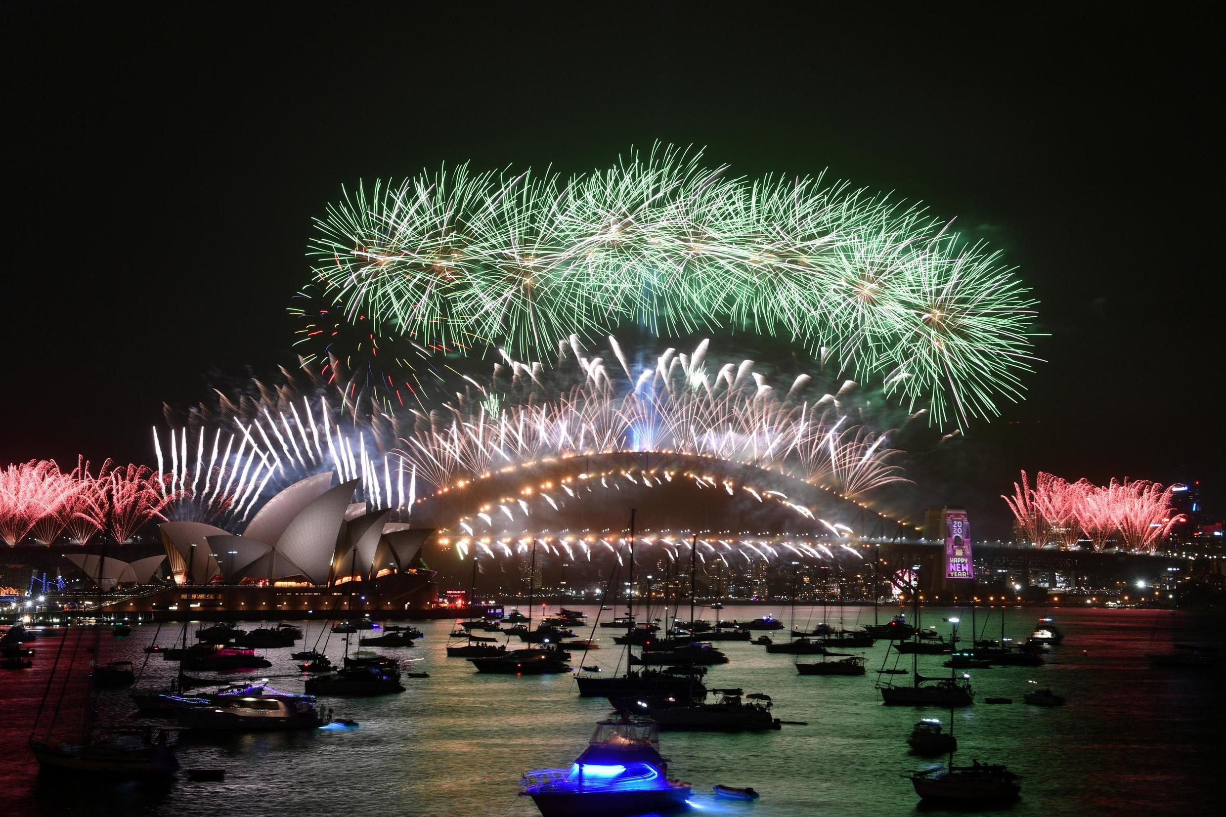 The midnight fireworks are seen from Mrs Macquarie's Chair during New Year's Eve celebrations in Sydney