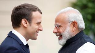 Emmanuel Macron greets Narendra Modi at the Elysée Palace last year