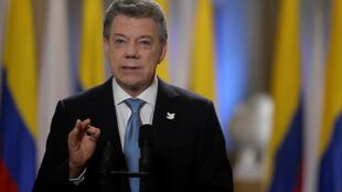 圖為哥倫比亞總統桑托斯宣布達成修改版和平新協議