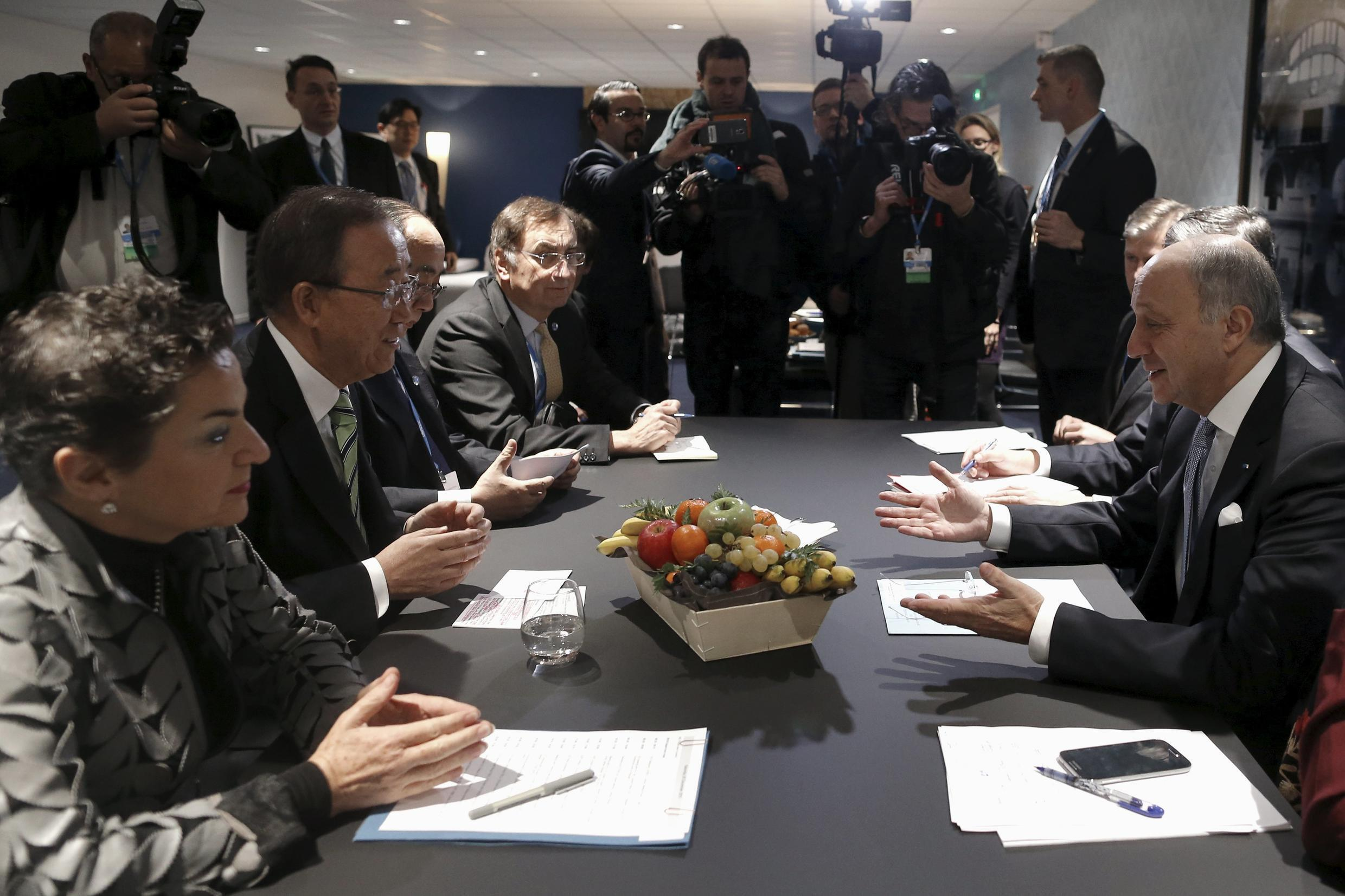 French Foreign Minister Fabius talks to United Nations Secretary General Ban and Executive Secretary of the UNFCCC Figueres during the COP21 at Le Bourget, near Paris, France, December 5, 2015.