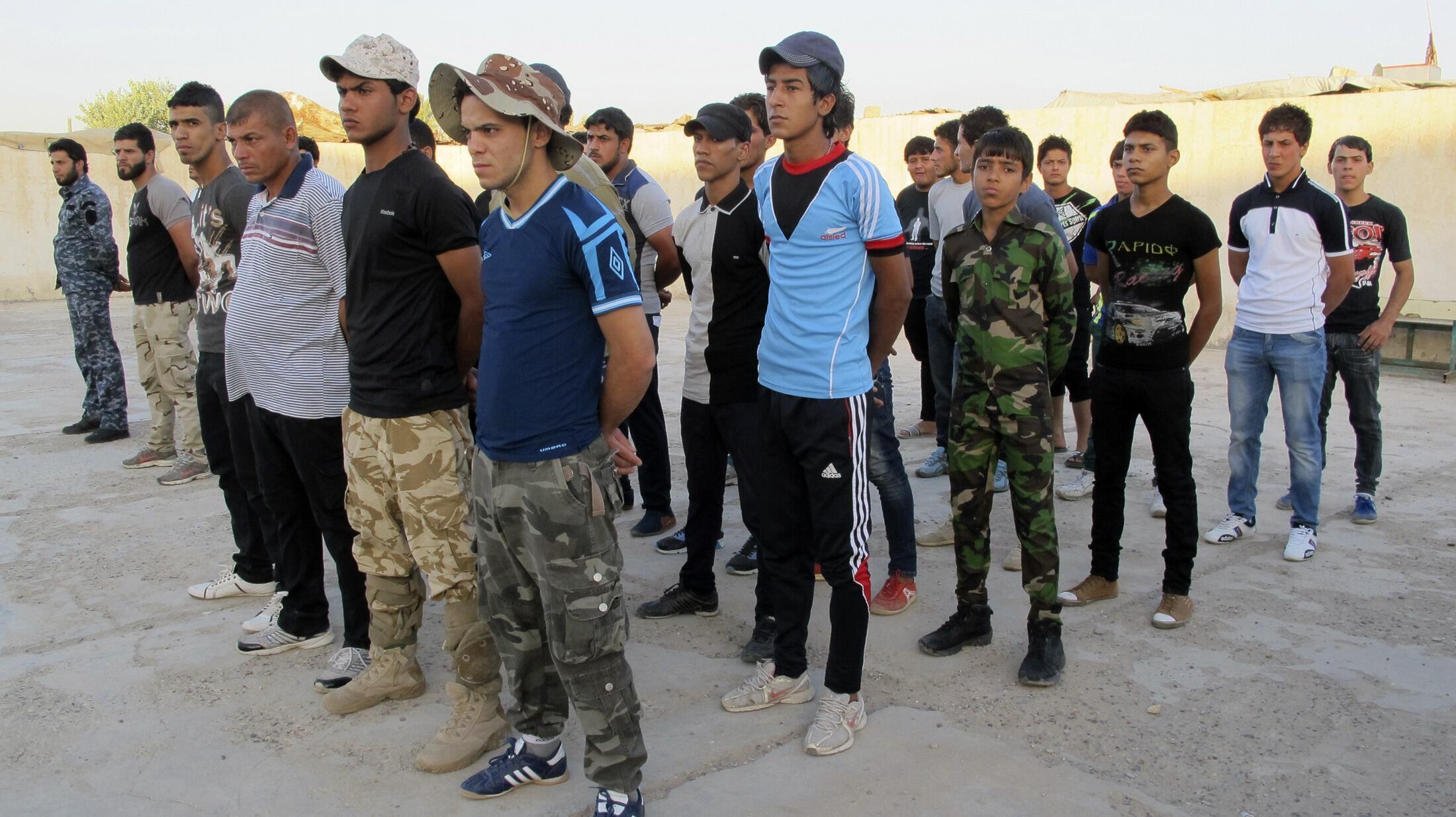 Des volontaires rejoignent les forces de sécurité le 17 juin, à Bagdad, pour combattre l'EIIL.