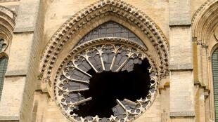 The rose window of the Gothic cathedral Saint-Gervais-et-Saint-Protais of Soissons broken in the storm