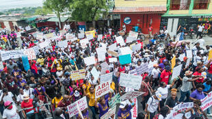 Protesters march in Port-au-Prince, Haiti on April 3, 2021
