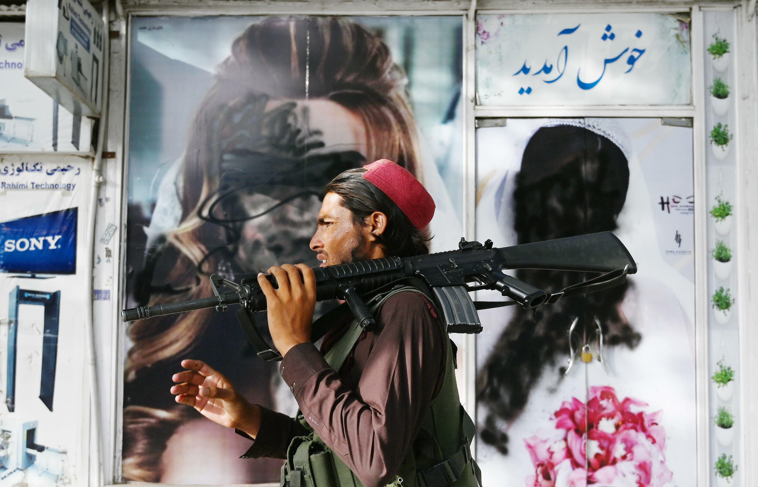 Images of women have been covered up or vandalised on storefronts around Kabul