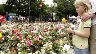 A child places a flower on a memorial to Breivik's victims in Oslo