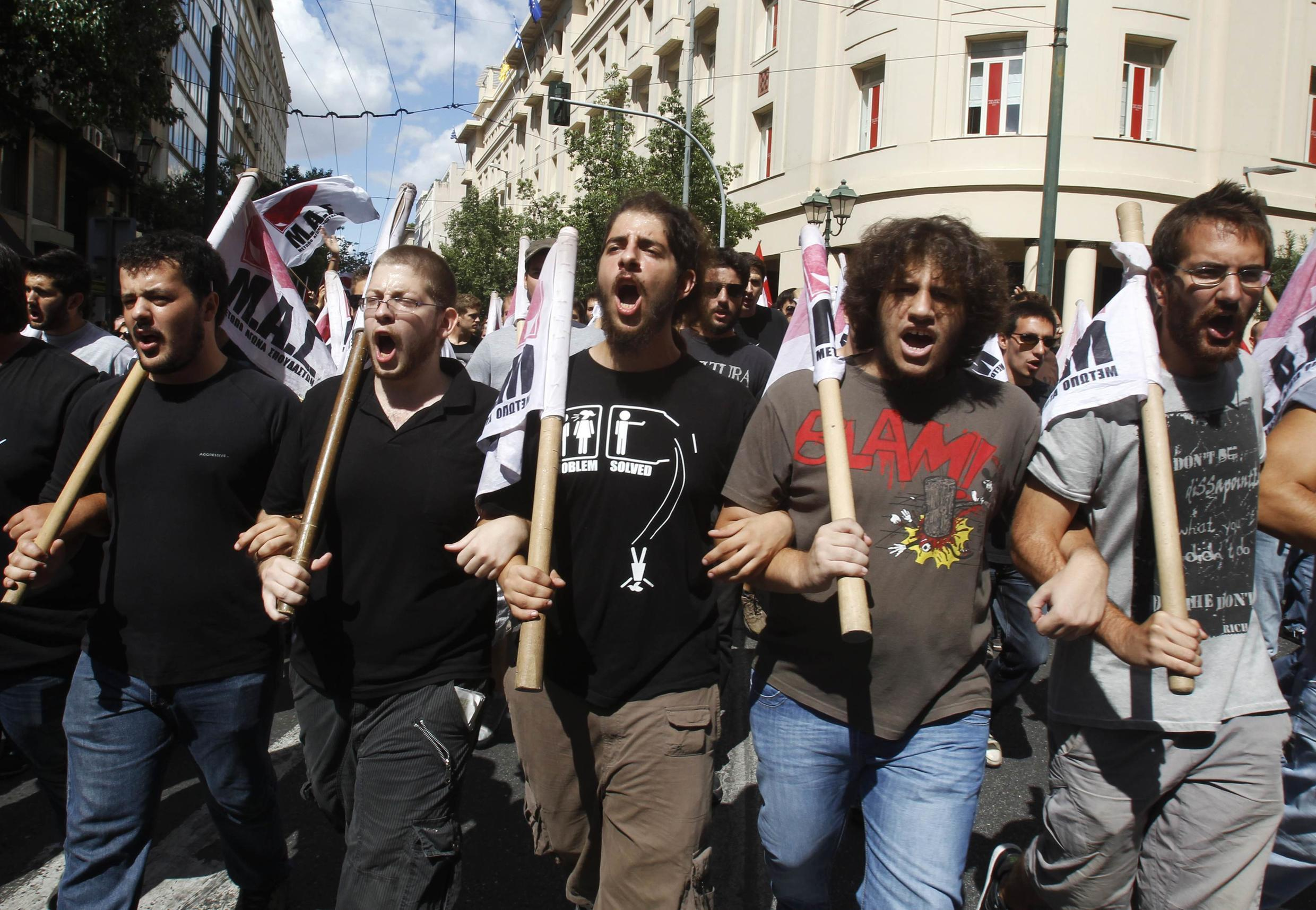 Greeks react with anger and disbelief at fresh cutbacks