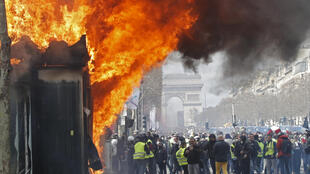 A newsagent's shop is set alight during a demonstration by Yellow Vest protestors in Paris last March.