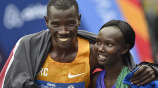 Stanley Biwott and Mary Keitany after crossing the finish line to win the 2015 New York City Marathon
