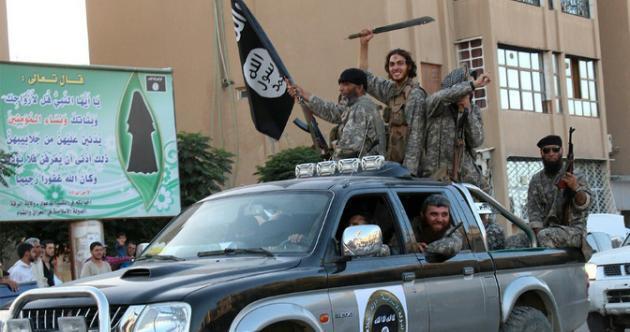 Боевики ИГИЛ в сирийской Ракке30 июня 2015