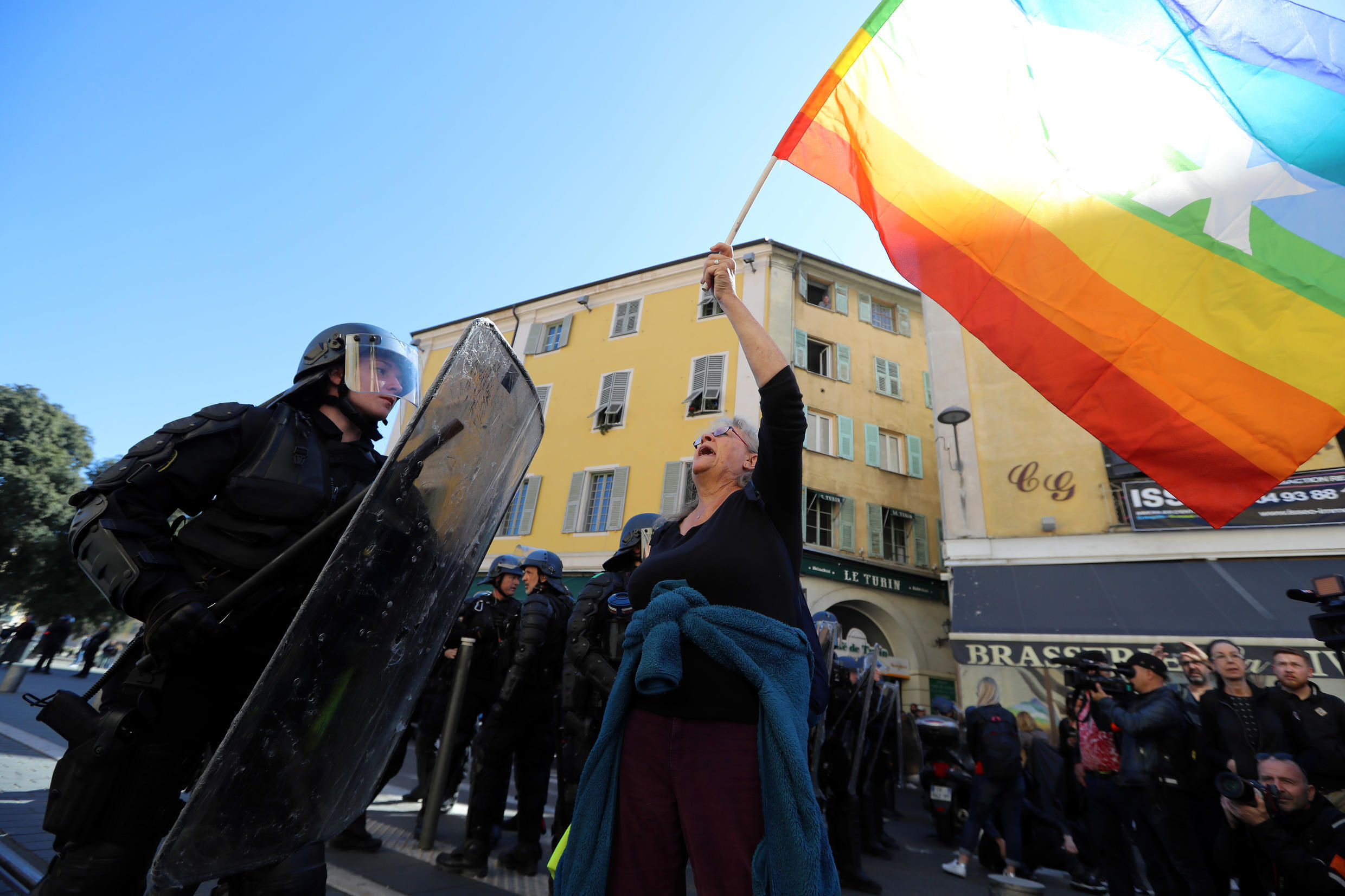 """Genevieve Legay, an Attac activtist, waves a coloured flag during a rally by the anti-government """"Yellow Vests"""" (Gilets jaunes) movement in the city of Nice, southeastern France, on March 23, 2019. Thousands of police fanned out across central Paris, Toulo"""