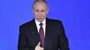 Vladimir Putin durante o seu discurso, sobre o estado da nação, diante do Parlamento russo. Moscovo. 01 de Março  de 2018