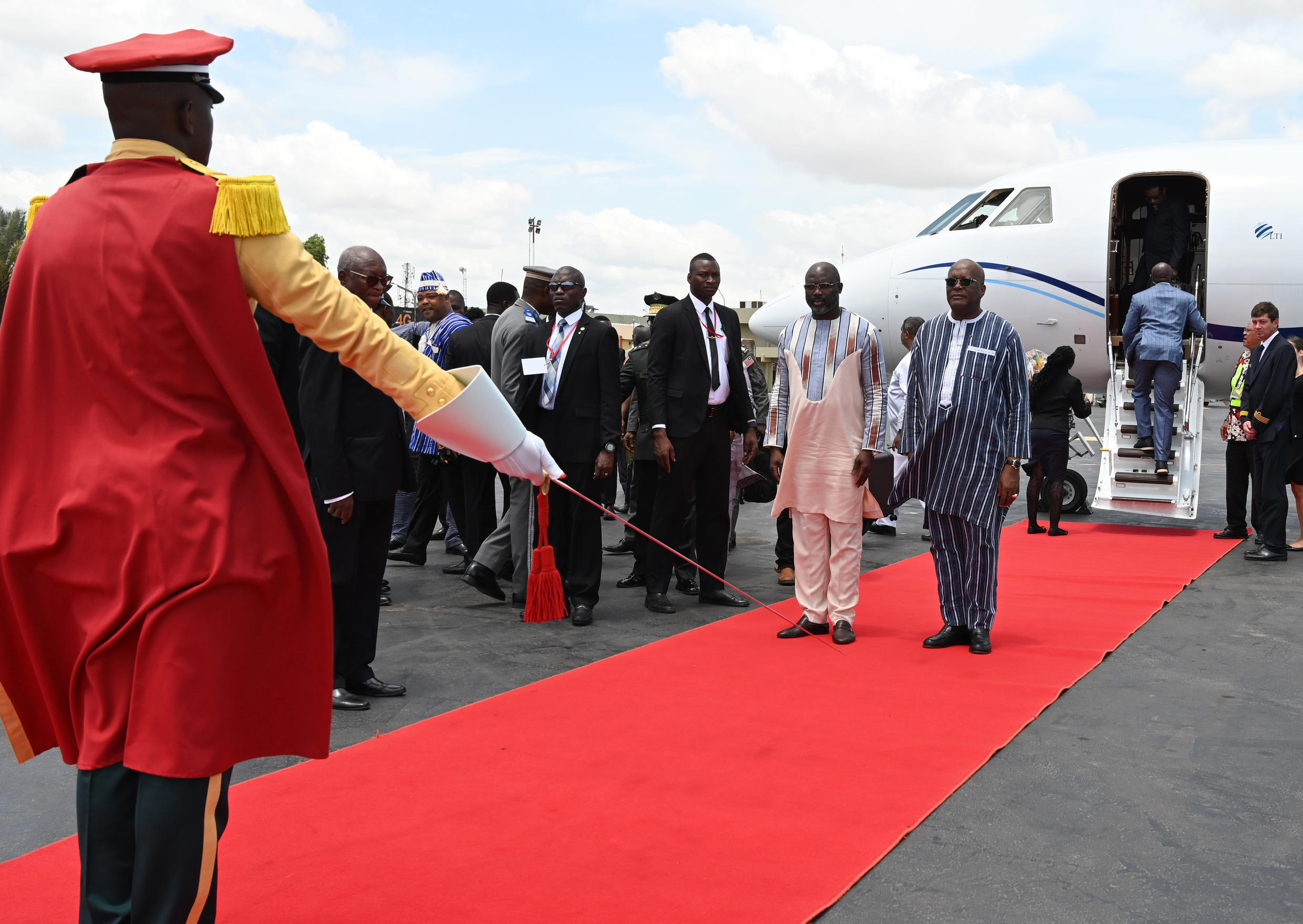 Weah arrives in Ouagadougou to meet President Roch Marc Christian Kabore, the private jet owned by Bonkoungou is pictured in the background, 13 September 2019.