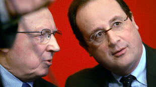 French President Francois Hollande with Jacques Delors, the former head of the European Commission and one of the architects of the euro