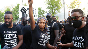 Assa Traore, sister of Adama Traore, raises her fist during a demonstration in Paris. Churning U.S. protests over George Floyd's death have revived anger in France over police violence, systemic racism and the complicated case of Adama Traore, a black Frenchman who died in police custody in 2016. For Traore's family, the Floyd protests have also revived their hopes for change.