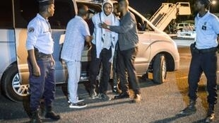 French national Peter Cherif (C) alleged associate of the Kouachi brothers, perpetrators of 2015 Charlie Hebdo attack, steps out a car as he is extradited to France at Djibouti International Airport in Djibouti on December 22, 2018. Cherif was arrested th