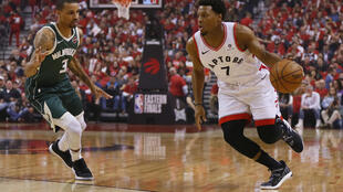 Kyle Lowry (right) scored 25 points for the Toronto Raptors in their game 4 victory over the Milwaukee Bucks in the Eastern Conference final.