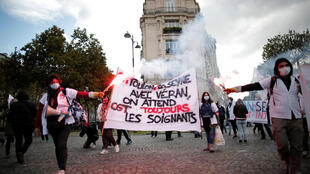 French health workers attend a protest in Paris as part of a nationwide day of actions to urge the government to increase staff as hospitals fill once again with COVID-19 patients, 15 October, 2020.