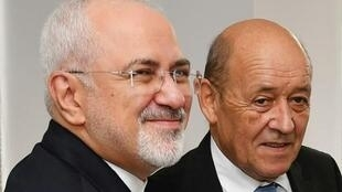 伊朗外长扎里夫(左)和法国外长勒德里昂准备就伊核问题举行双边会谈       2018年9月24日