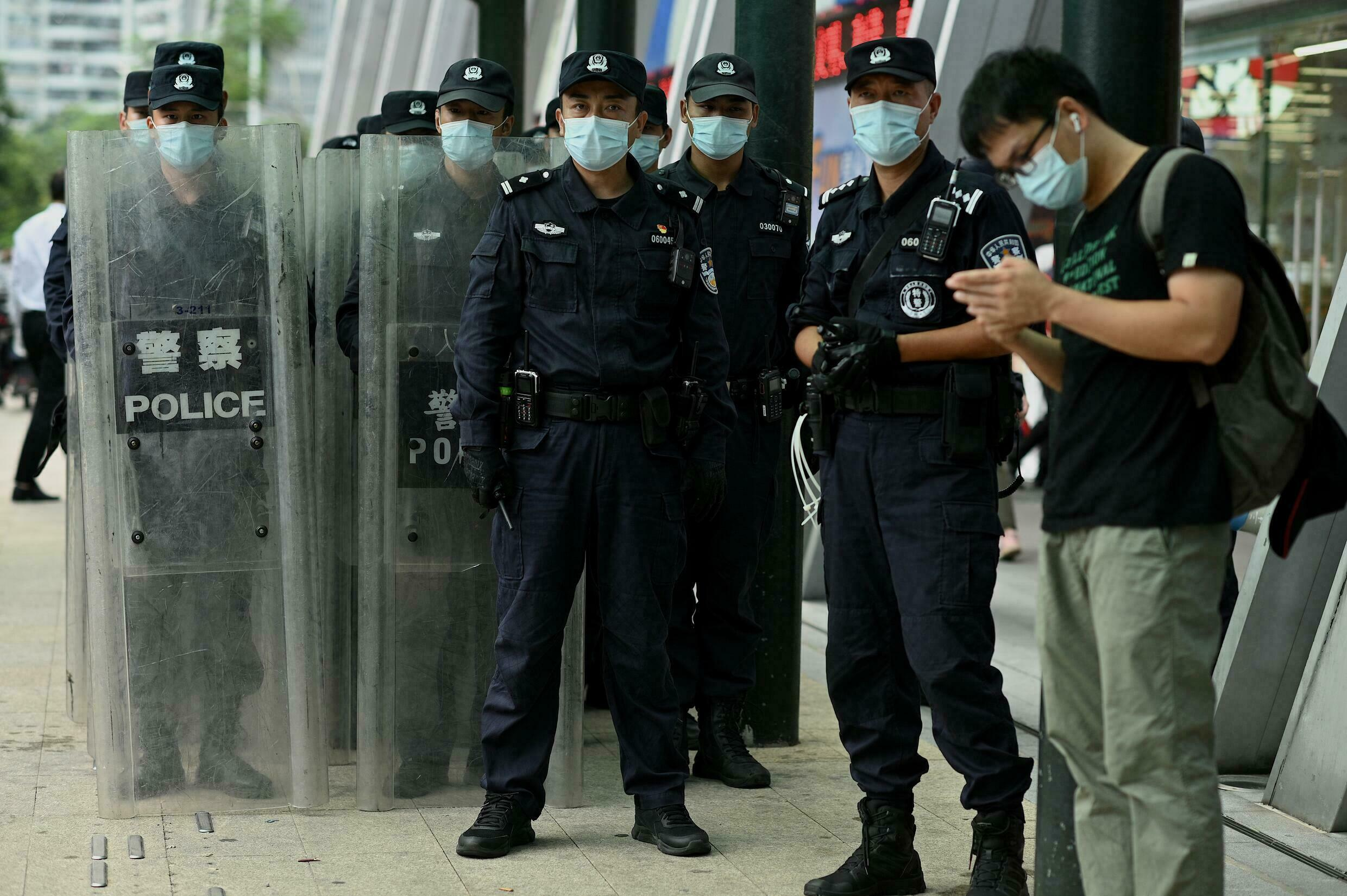 Policemen stood guard outside Evergrande's headquarters as anger grew over the housing giant's debt crisis mounted