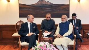 India's Prime Minister Narendra Modi speaks with French Foreign Minister Laurent Fabius (L) during a meeting at his residence in New Delhi July 1, 2014.