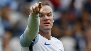 England captain Wayne Rooney has dropped into a midfield role under manager Roy Hodgson.