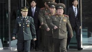 North Korean officers walk south of the truce village of Panmunjom in Paju