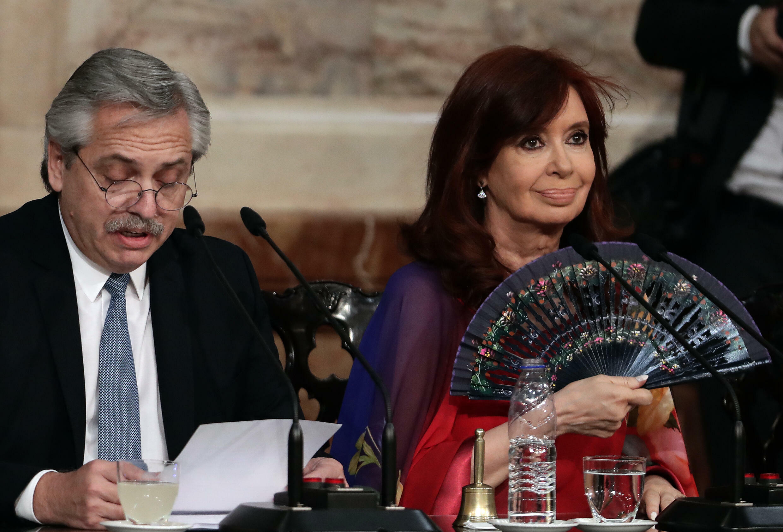 In this file photo taken in March 2020, Argentine President Alberto Fernandez (L) delivers a speech, next to Vice President Cristina Fernandez de Kirchner,