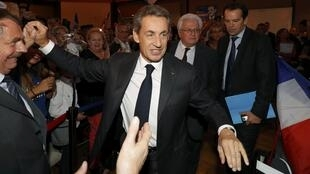 Nicolas Sarkozy, former head of the Les Republicains political party, arrives for a political rally in Franconville, France, as part of his campaign for the French conservative presidential primary on 19 September, 2016.