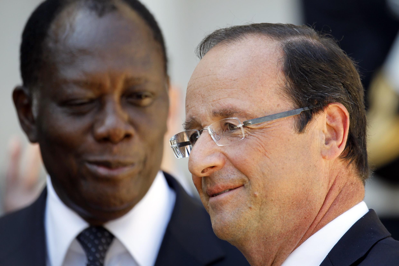 François Hollande (R) and Alassane Ouattara  at the Elysée
