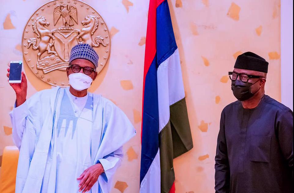 Nigerian President Muhammadu Buhari and Minister of Industries Otunba Niyi Adebayo