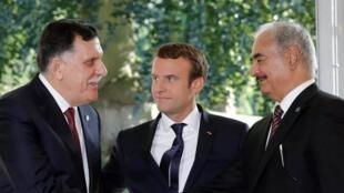 French President Emmanuel Macron hosts Libyan Prime Minister Fayez al-Sarraj and opponent General Khalifa Haftar in Paris, 2017