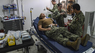 Soldiers demonstrate medical equipment used to stabilise patients at the Covid-19 Intensive Care Unit (ICU) facility at Camp Lemonnier, Djibouti, 9 April 2020.