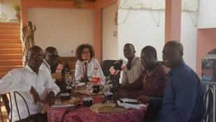 De g. à dr. : Moussa, Dia, Didier Acouetey, Emmanuelle Bastide, Jean-Luc Semedo, Baba Diallo et Labaly Touré.