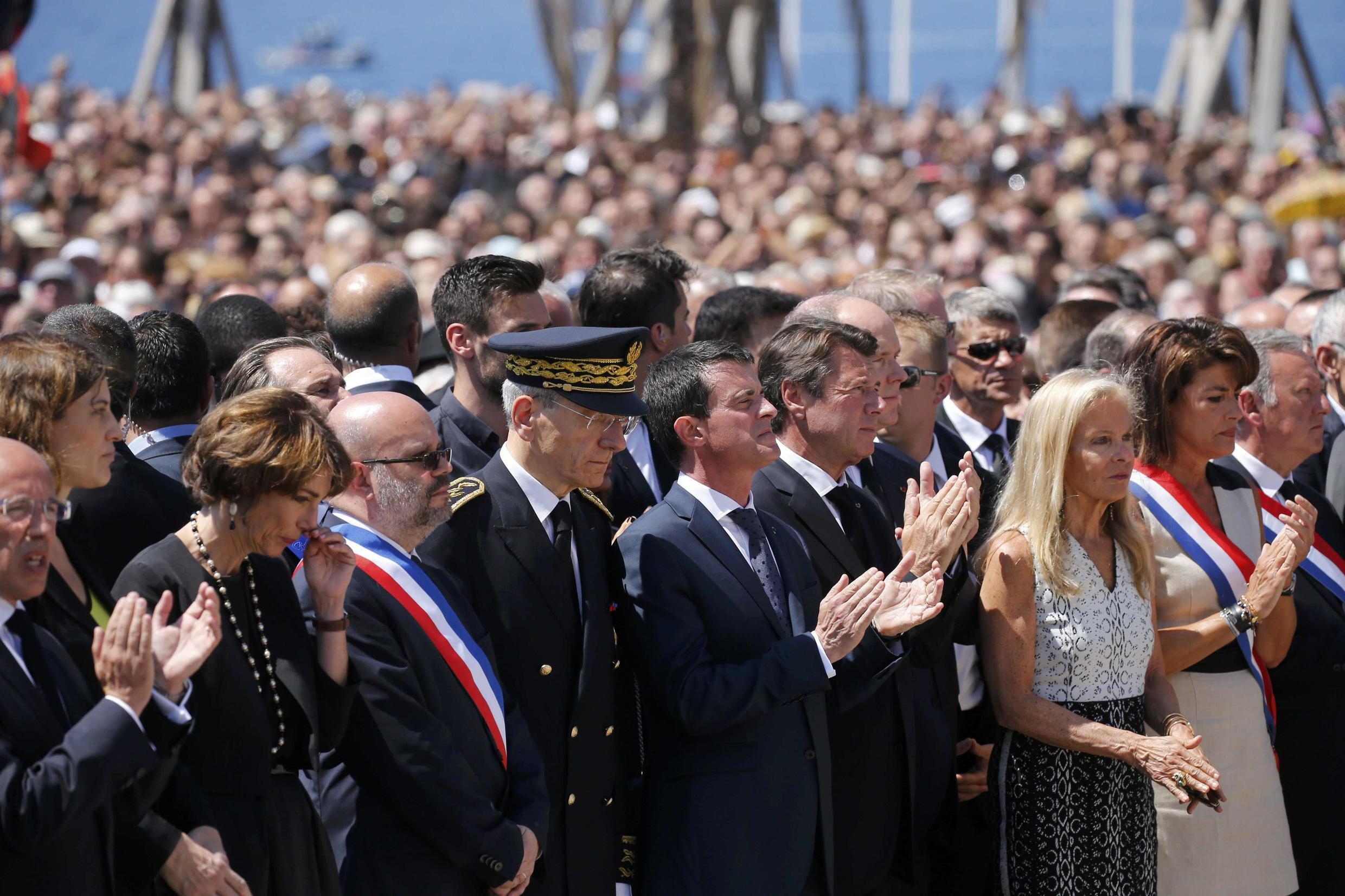 French Prime Minister Manuel Valls (C), who was booed by part of the crowd, at the minute's silence for the victims in Nice on Monday